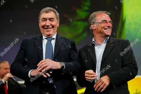 Five-time Tour de France winners Eddy Merckx, from Belgium, left, and Bernard Hinault from France attend the presentation of the 2019 Tour de France cycling race, in Paris, . The 106th edition of the race starts on July 6 2019 to end on the Champs-Elysees avenue on July 28