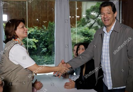 Laura Chinchilla, Fernando Haddad. Laura Chinchilla, head of the OAS Electoral Observation Mission and former President of Costa Rica, shakes hands with Workers' Party presidential candidate Fernando Haddad, in Sao Paulo, Brazil, . Haddad will face presidential frontrunner Jair Bolsonaro in a runoff on Sunday