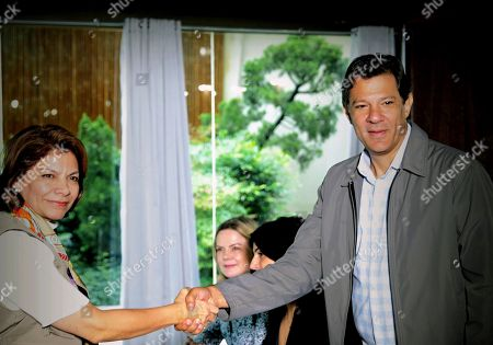 The head of the mission of the Organization of American States (OAS) and former President of Costa Rica Laura Chinchilla (L) meets with the candidate for the presidency of Brazil for the Workers' Party (PT) Fernando Haddad (R) in Sao Paulo, Brazil, 25 October 2018. The meeting, on the request of the Workers' Party, is to analyze complaints on fake news and issues of political violence among other issues.