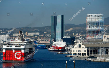 General view of La Marseillaise Tower (R) builded by French architect Jean Nouvel, in Marseille, Southern France, 25 October 2018. La Marseillaise tower, an 'environment friendly' new skyscraper is 135 metres high and uses marine geothermal energy for heating and cooling.