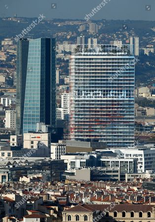 General view of La Marseillaise Tower (R),  build by French architect Jean Nouvel, in Marseille, Southern France, 25 October 2018. La Marseillaise tower, an 'environment friendly' new skyscraper is 135 metres high and uses marine geothermal energy for heating and cooling.