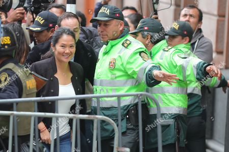 The President of the party Fuerza Popular Keiko Fujimori (C-L), along with her husband Mark Vito, arrives at the National Criminal Chamber, in Lima, Peru, 25 October 2018. Keiko Fujimori is attending the resumption of the hearing where the Prosecutor's Office is requesting preventive detention. Reports state that Fujimori is now facing a 36-month preventive detention requested, by Anti-corruption prosecutor Jose Domingo Perez, against the alleged money laundering allegations.