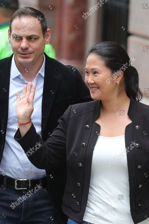 The President of the party Fuerza Popular Keiko Fujimori (R), along with her husband Mark Vito, arrives at the National Criminal Chamber, in Lima, Peru, 25 October 2018. Keiko Fujimori is attending the resumption of the hearing where the Prosecutor's Office is requesting preventive detention. Reports state that Fujimori is now facing a 36-month preventive detention requested, by Anti-corruption prosecutor Jose Domingo Perez, against the alleged money laundering allegations.