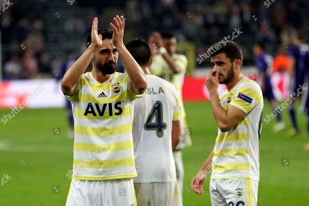 Fenerbahce's Hasan Ali Kaldirim, left, applauds supporters with teammates at the end of the Europa League Group D soccer match between Anderlecht and Fenerbahce at the Constant Vanden Stock stadium in Brussels, . Ali Kald?r?m scored once and the match ended in a 2-2 draw