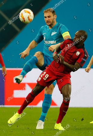 Branislav Ivanovic (L) of FC Zenit in action against Maxime Poundje (R) of FC Girondins de Bordeaux during the UEFA Europa League group C soccer match between FC Zenit St. Petersburg and FC Girondins de Bordeaux in St. Petersburg, Russia, 25 October 2018.