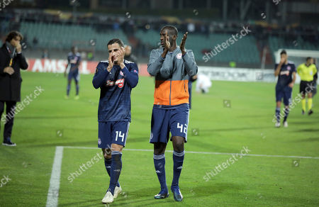 Olympiacos Omar Elabdellaoui, left, and Olympiacos Yaya Toure celebrate after their team won their Europa League group F soccer match between Dudelange and Olympiacos at the Josy Barthel stadium in Luxembourg
