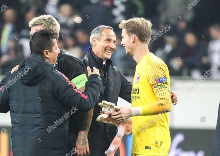 Frankfurt's head coach Adolf Huetter (C) greets his goalkeeper Frederik Ronnow (R) after winning the UEFA Europa League group H soccer match between Eintracht Frankfurt and Apollon Limassol in Frankfurt Main, Germany, 25 October 2018.