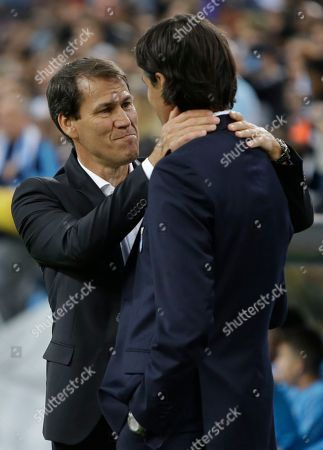 Marseille's coach Rudi Garcia, left, hugs Lazio coach Simone Inzaghi, the prior to the start of the Europa League, Group H soccer match between Marseille and Lazio at the Velodrome Stadium in Marseille, France