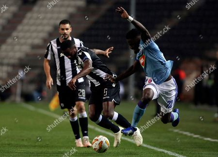 PAOK's Fernando Varela, Left, and Vidi's Stopira, Right, fight for the ball during a Group L Europa League soccer match between PAOK and Vidi at Toumba stadium in the northern Greek port city of Thessaloniki