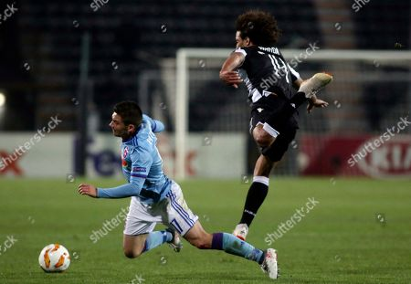 PAOK's Amr Warda, Right, and Vidi's Mate Patkai fight for the ball during a Group L Europa League soccer match between PAOK and Vidi at Toumba stadium in the northern Greek port city of Thessaloniki