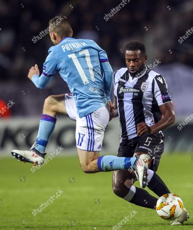 PAOK Salonica's Fernando Varela R) in action with Vidi's Máté Pátkai (L)  during the UEFA Europa League third qualifying round, group L soccer match between PAOK Thessaloniki and Vidi in Toumba stadium in Thessaloniki, northern Greece, 25 October 2018.
