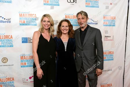Festival Director Sandra Seeling Lipsk poses next to US actress Melissa Leo and Danish actor Mads Mikkelsen upon arrival to the inauguration ceremony of the 7th Evolution Mallorca International Film Festival held at the Main Theater in Palma de Mallorca, Balearic Islands, Spain, 25 October 2018. The event runs from 25 to 31 October 2018.