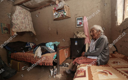 Julia Flores Qolque, widely known in Bolivia as 'Mama Julia', sits at her room in Sacaba, 18 kms from Cochabamba, Bolivia, 25 October 2018. Sacaba's City Hall wants to present 'Mama Julia' to the Guiness World Record to be recognized as the eldest person in Bolivia and in the world as she will be 118 years-old on 26 October 2018..