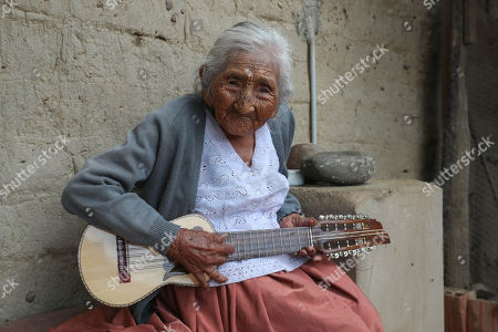 Julia Flores Qolque, widely known in Bolivia as 'Mama Julia', plays the 'charango' at her house in Sacaba, 18 kms from Cochabamba, Bolivia, 25 October 2018. Sacaba's City Hall wants to present 'Mama Julia' to the Guiness World Record to be recognized as the eldest person in Bolivia and in the world as she will be 118 years-old on 26 October 2018..