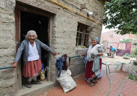 Julia Flores Qolque (L), widely known in Bolivia as 'Mama Julia', and her nephew-granddaughter Agustina Berna (R), at her house in Sacaba, 18 kms from Cochabamba, Bolivia, 25 October 2018. Sacaba's City Hall wants to present 'Mama Julia' to the Guiness World Record to be recognized as the eldest person in Bolivia and in the world as she will be 118 years-old on 26 October 2018..