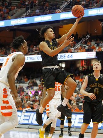 Saint Rose's Adam Anderson, center, shoots during the second half of an NCAA college basketball game against Syracuse in Syracuse, N.Y
