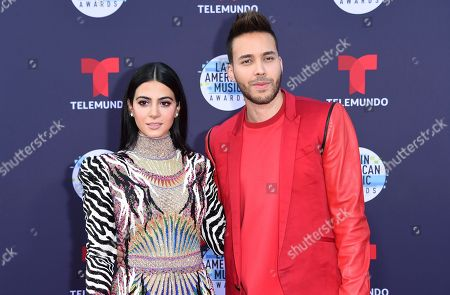 Emeraude Toubia, Prince Royce. Emeraude Toubia, left, and Prince Royce arrive at the Latin American Music Awards at the Dolby Theatre, in Los Angeles