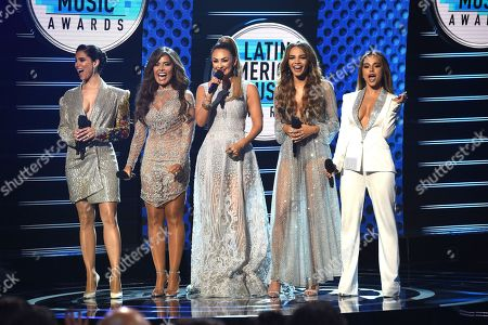 Roselyn Sanchez, Gloria Trevi, Aracely Arambula, Leslie Grace, Becky G. Hosts Roselyn Sanchez, from left, Gloria Trevi, Aracely Arambula, Leslie Grace and Becky G appear on stage at the Latin American Music Awards at the Dolby Theatre, in Los Angeles