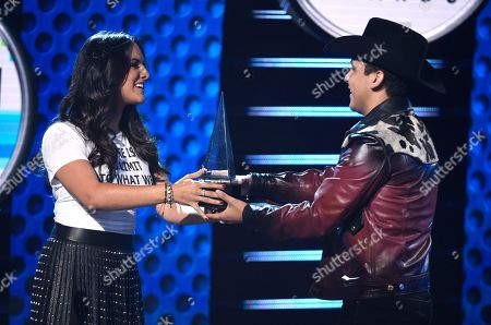 """Ana Lorena Sanchez, Christian Nodal. Ana Lorena Sanchez, left, presents Christian Nodal with the award for favorite regional Mexican album for """"Me Deje Llevar"""" at the Latin American Music Awards at the Dolby Theatre, in Los Angeles"""