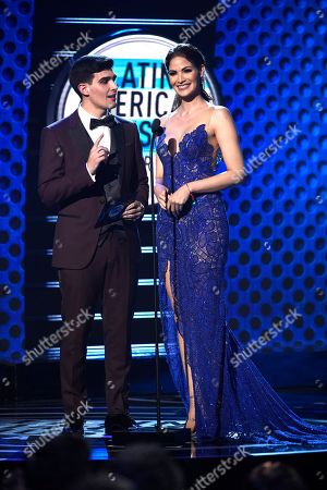 Adriel Favela, Cynthia Olavarria. Adriel Favela, left, and Cynthia Olavarria present the award for favorite video at the Latin American Music Awards at the Dolby Theatre, in Los Angeles