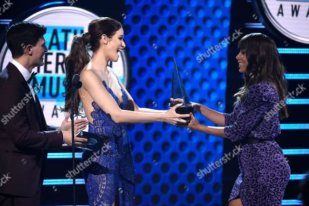 """Stock Picture of Anitta, Adriel Favela, Cynthia Olavarria. Anitta, right, accepts the award for favorite video for """"Medicina"""" from Adriel Favela, from left, and Cynthia Olavarria at the Latin American Music Awards at the Dolby Theatre, in Los Angeles"""