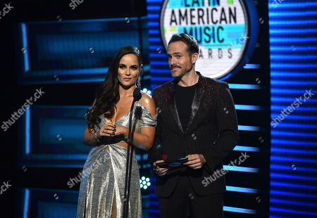Ana Lucia Dominguez, Erik Hayser. Ana Lucia Dominguez, left, and Erik Hayser present the award for favorite pop artist at the Latin American Music Awards at the Dolby Theatre, in Los Angeles