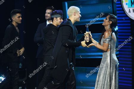 Ana Lucia Dominguez, CNCO. Ana Lucia Dominguez, right, presents the award for favorite pop artist to CNCO at the Latin American Music Awards at the Dolby Theatre, in Los Angeles