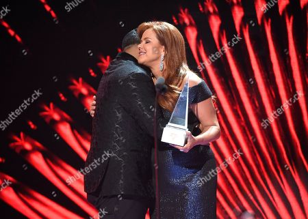 Daddy Yankee, Maria Celeste Arraras. Maria Celeste Arraras, right, presents Daddy Yankee with the Icon Award at the Latin American Music Awards at the Dolby Theatre, in Los Angeles