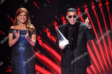 Daddy Yankee, Maria Celeste Arraras. Maria Celeste Arraras, left, presents Daddy Yankee with the Icon Award at the Latin American Music Awards at the Dolby Theatre, in Los Angeles