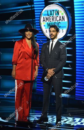 Litzy, Shalim Ortiz. Litzy, left, and Shalim Ortiz present the award for favorite pop album at the Latin American Music Awards at the Dolby Theatre, in Los Angeles