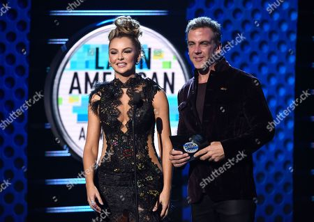Carlos Ponce, Marjorie de Sousa. Carlos Ponce, right, and Marjorie de Sousa present the award for favorite urban song at the Latin American Music Awards at the Dolby Theatre, in Los Angeles