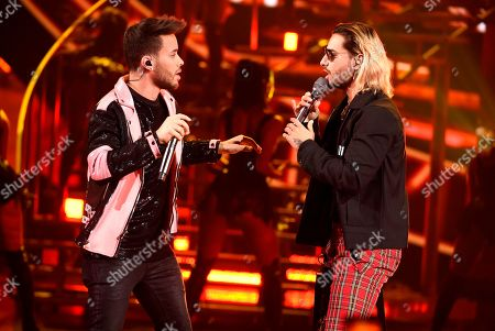 """Prince Royce, Maluma. Prince Royce and Maluma perform """"El Clavo"""" at the Latin American Music Awards at the Dolby Theatre, in Los Angeles"""