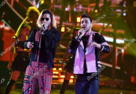 """Prince Royce, Maluma. Prince Royce, right, and Maluma perform """"El Clavo"""" at the Latin American Music Awards at the Dolby Theatre, in Los Angeles"""