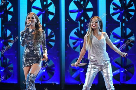 """Leslie Grace, Becky G. Leslie Grace, left, and Becky G perform """"Diganle"""" at the Latin American Music Awards at the Dolby Theatre, in Los Angeles"""