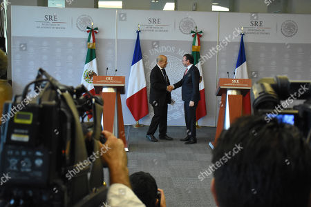Stock Photo of Jean-Yves Le Drian, Minister of Europe and Foreign Affairs (L) and Mexico's Foreign Affairs Luis Videgaray Caso during a press conference as part of Minister of Europe and Foreign Affairs working visit to Mexico at Ministry of Foreign Affairs of Mexico on October 25, 2018 in Mexico City, Mexico