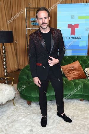 Erik Hayser poses backstage at the Latin American Music Awards at the Dolby Theatre, in Los Angeles