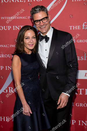 "Stock Image of Margaret Russell, John Bossard. Margaret Russell and John Bossard attend the Fashion Group International's annual ""Night of Stars"" gala at Cipriani Wall Street, in New York"