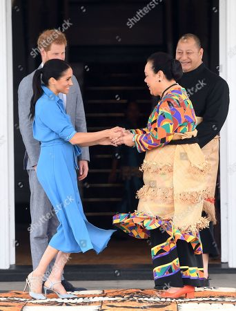 Stock Photo of Prince Harry and Meghan Duchess of Sussex meet with King Tupou VI and Queen Nanasipau'u