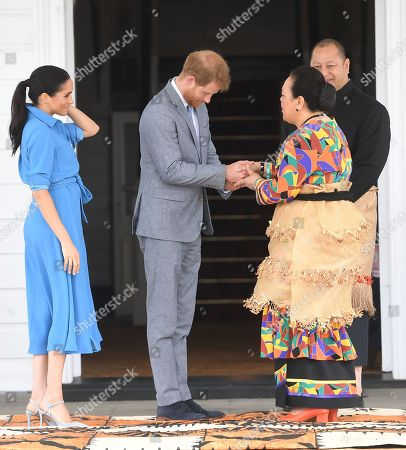 Stock Picture of Prince Harry and Meghan Duchess of Sussex meet with King Tupou VI and Queen Nanasipau'u