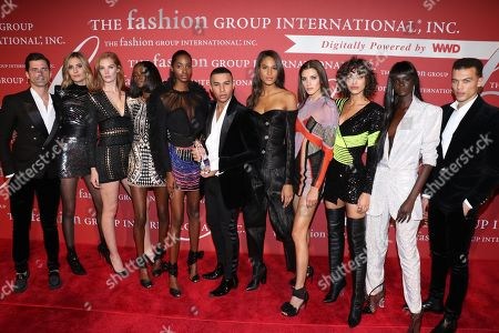 Sean O'Pry, Nadja Bender, Alexina Graham, Riley Montana, Tami Williams, Olivier Rousteing, Cindy Bruna, Valery Kaufman, Alanna Arrington, Duckie Thot, and Dudley O'Shaughnessy attend as the 'Balmain Army'