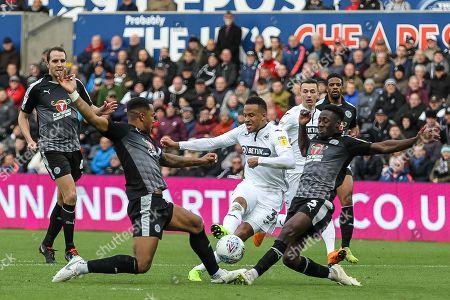 Martin Olsson of Swansea City has a shot