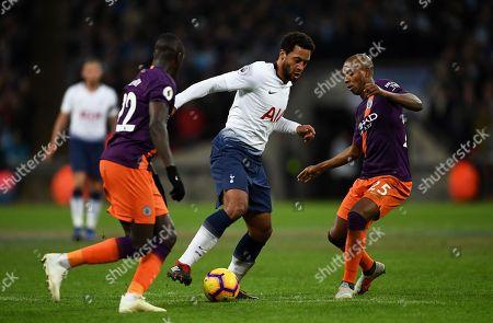 Mousa Dembele of Tottenham Hotspur goes through Benjamin Mendy of Manchester City and Fernandinho of Manchester City