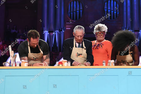 Jason Fox, Nick Hewer, Alan Carr dressed as Pru Leith and Kadeena Cox during Bake-Off challenge