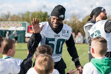Philadelphia Eagles LaRoy Reynolds LB (50) high fives the kids during the flag event during the press, training and media day for Philadephia Eagles at London Irish Training Ground, Hazelwood Centre. Picture by Jason Brown