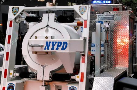 A New York City police containment vessel truck transports an explosive device found at a US mail facility on West 52nd street in New York, New York, USA, 26 October 2018. This being the 12th suspicious package found, it was addressed to former Director of National Intelligence James Clapper.