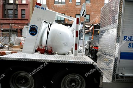 Stock Image of A New York City police containment vessel truck transports an explosive device found at a US mail facility on West 52nd street in New York, New York, USA, 26 October 2018. This being the 12th suspicious package found, it was addressed to former Director of National Intelligence James Clapper.