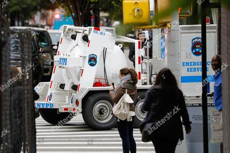 Stock Photo of A New York City police containment vessel truck transports an explosive device found at a US mail facility on West 52nd street in New York, New York, USA, 26 October 2018. This being the 12th suspicious package found, it was addressed to former Director of National Intelligence James Clapper.