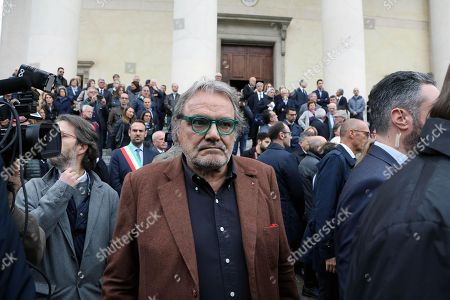 Italian photographer Oliviero Toscani arrives for the funeral service held in Treviso, northern Italy, 26 October 2018. Gilberto Benetton died on 22 October at the age of 77 after a long illness. He was the second of four brothers who in 1965 founded the famous fashion group that then spread into other sectors, including finance.