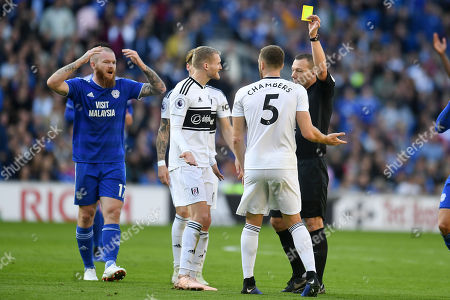 Fulham player Calum Chambers receives a yellow card from referee Kevin Friend