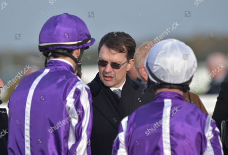 (C) Aidan OBrien, trainer of Magna Grecia with (L) jockey, Donnacha OBrien, and (R) jockey, Michael Hussey before winning The Vertem Futurity Trophy Stakes.